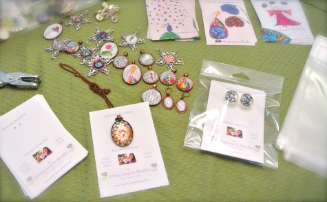 Artist Emily Lupita of Emily Lupita Studio creating handcrafted artwork jewelry wearable art