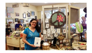 Local artist Emily Lupita of Emily Lupita Studio with her handcrafted art jewelry at The Local Exchange